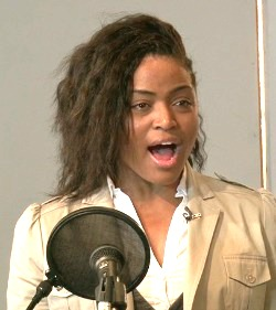 Female singer practises vocal cord exercises