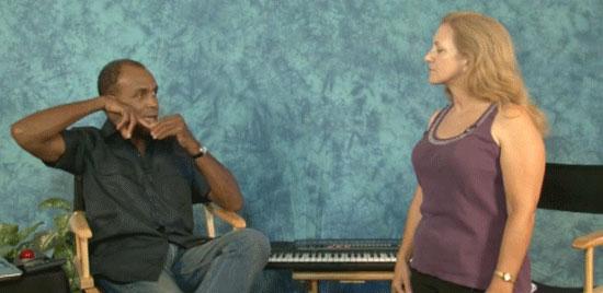 Vocal teacher demonstrating a vocal range exercise